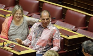 Lawmaker Yanis Varoufakis speaks with other parliament members. Greek Prime Minister Alexis Tsipras defended his flamboyant former finance minister.