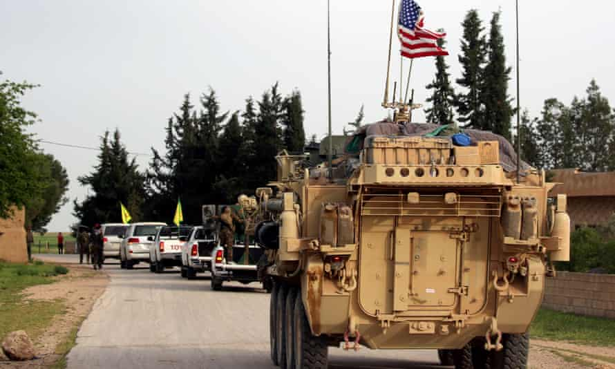 US forces, accompanied by Kurdish People's Protection Units (YPG) fighters, driving near the northern Syrian village of Darbasiyah.
