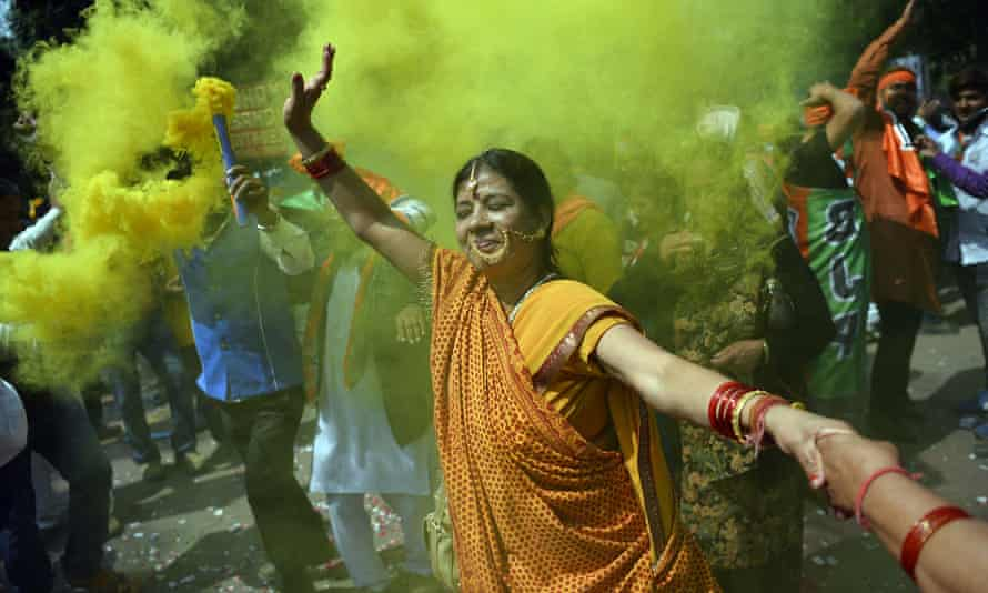 Supporters of the BJP celebrate a stunning election victory in Uttar Pradesh.