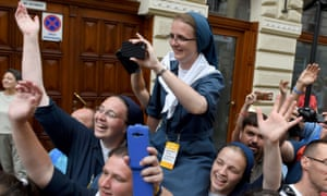 Nuns take pictures of Pope Francis arriving at Wawel castle in Krakow