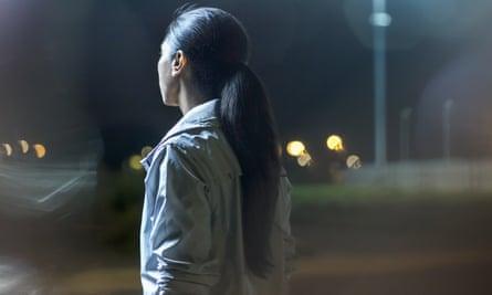 Woman alone at night