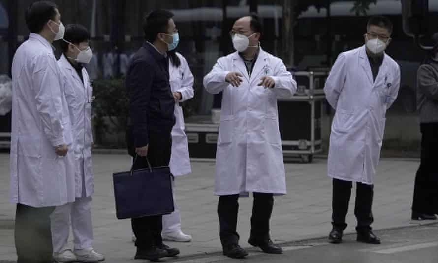 Chinese medical staff outside the Hubei Province Xinhua hospital in Wuhan as the WHO team leaves.