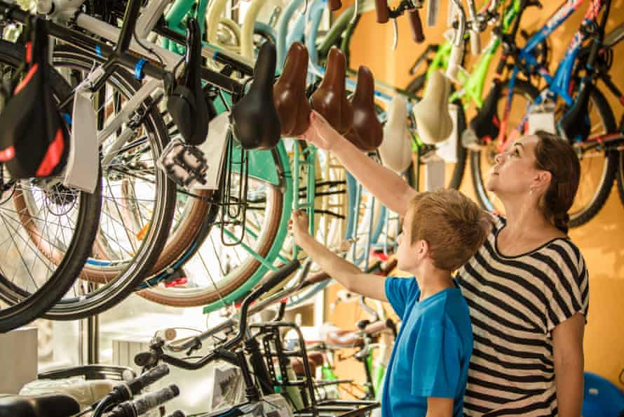 Women and son browse bikes in a cycle shop