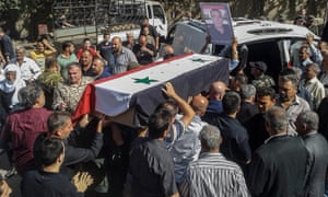 Mourners carry coffins of three of the 216 who were killed by Isis fighters in Sweida province.