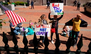 Protesters rally against stay-at-home orders related to the coronavirus pandemic outside Capitol Square in Richmond, Virginia.