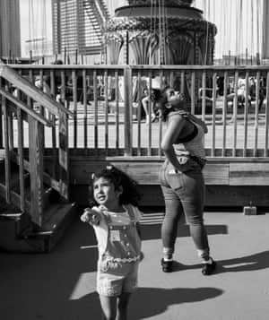 Young people watch an amusement ride on Steel Pier on the Atlantic City, New Jersey, Boardwalk. May 2018