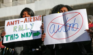 Opponents of Airbnb rally at City Hall in New York in 2015.