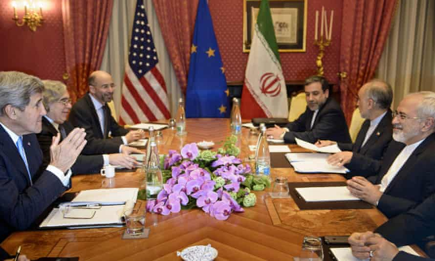 Iran's deputy foreign minister Abbas Araghchi, third right, takes part in talks in Switzerland in March on Iran's nuclear weapons programme with the foreign minister, Javad Zarif, far right, and the US secretary of state, John Kerry, far left.