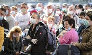 Seasonal workers wait to board flights to Germany in Cluj, Romania, 9 April 2020