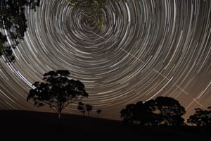 Just Missed the Bullseye Scott Carnie-Bronca (Australia) The International Space Station (ISS) appears to pierce a path across the radiant, concentric star trails seemingly spinning over the silhouettes of the trees in Harrogate, South Australia.