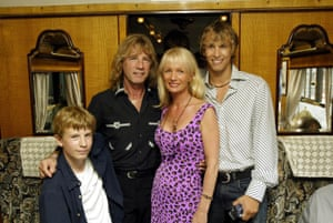 Rick Parfitt with sons Harry and Richard and wife Pat heading to Portsmouth on the Orient Express to perform on HMS Ark Royal to promote the Quo album Heavy Traffic on 30 July 2002