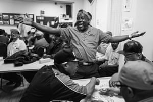 Kenrick wins a domino match at the West Indian Association of Service Personnel in Clapham, from Windrush generation portraits by Jim Grover
