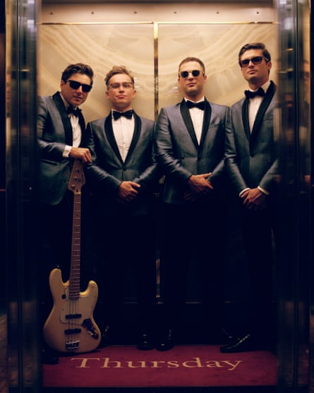 Adam Langstaff (second right), with onboard covers band the Runaround Kids.