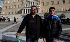 Dimitris Orfanoudakis and his son, Giorgos, outside the Greek parliament