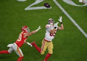Daniel Sorensen , free safety for the Kansas City Chiefs, tries to stop San Francisco 49ers tight end George Kittle from catching the ball.