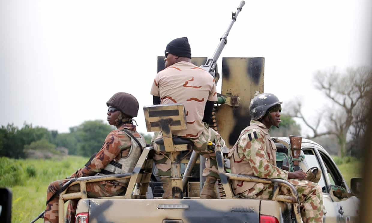 Nigerian Islamists kill scores of soldiers in military base attack (theguardian.com)