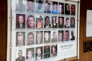 Photos of the 29 deceased miners are shown on display at the public memorial on the access road to the Pike River Mine