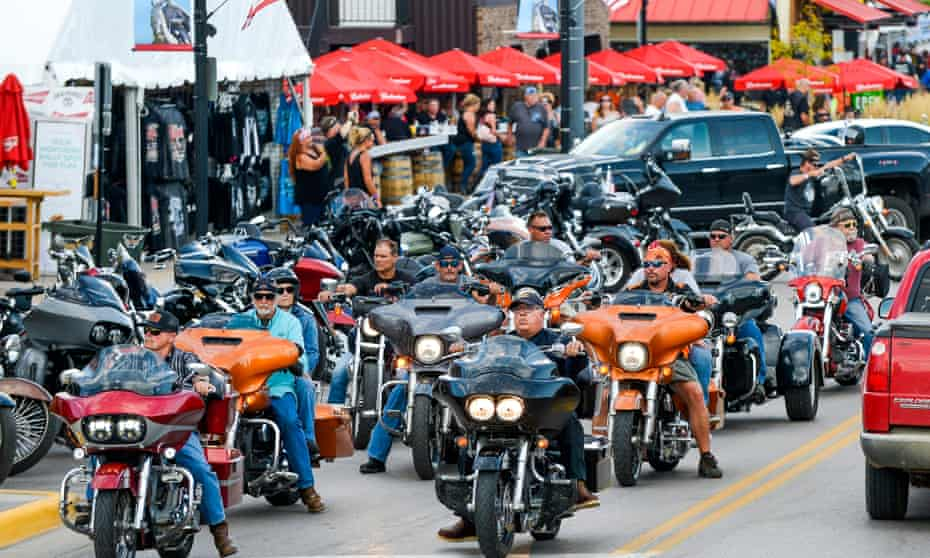 Motorcyclists ride down Main Street in Sturgis on Thursday. South Dakota has fared better than most states but cases have increased recently.