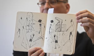 Archivist Stefan Litt shows drawings from one of Franz Kafka's notebooks.
