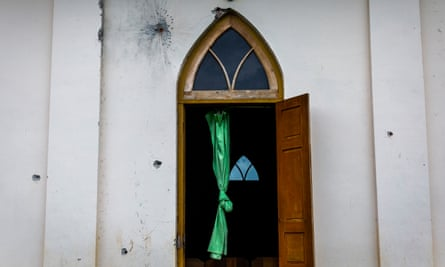 Bullets marks are seen on the wall of Kachin baptist church in Nam San Yang village