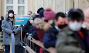 People line up to receive a dose of Sputnik V (Gam-COVID-Vac) vaccine against coronavirus in Moscow.