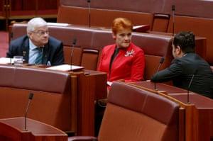 Labor's senator Sam Dastyari talks to Pauline Hanson and Brian Burston