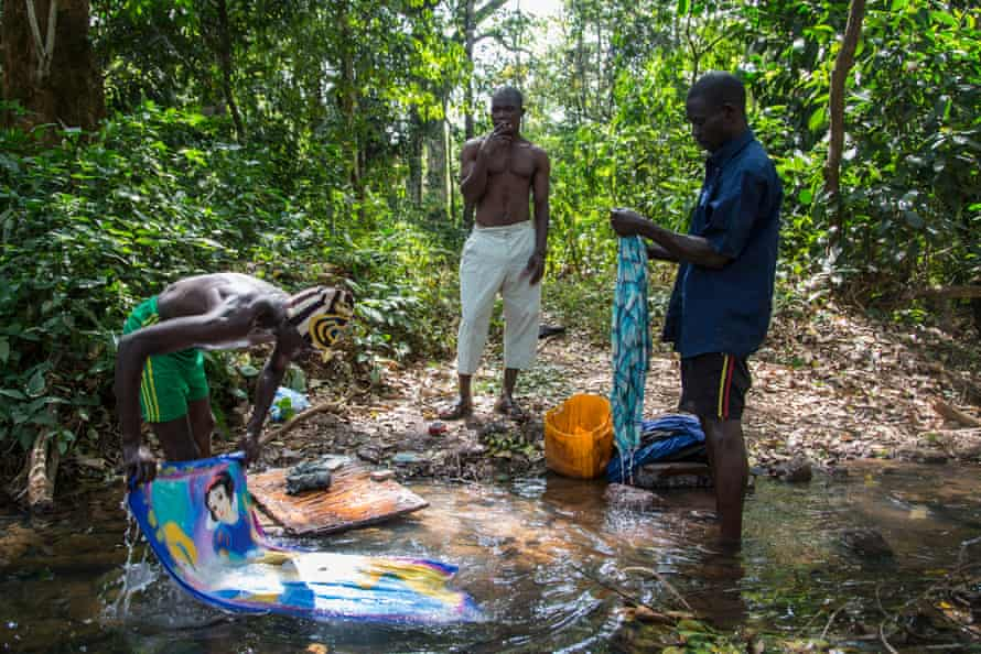 Sunday is wash-day. Chinko workers head down to the forest near the reserve's main camp to chill in the shade, listen to music and wash their clothes and other belongings in a stream.