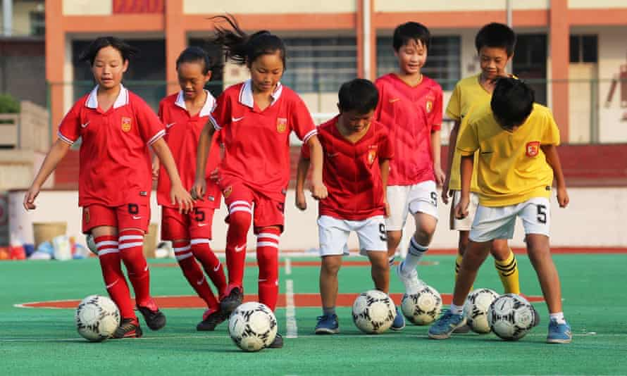 Pupils of the Anbing Primary School take part in a football training in Yongxing Town of Huaying City, Sichuan Province.