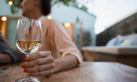 Woman drinking white wine on patio