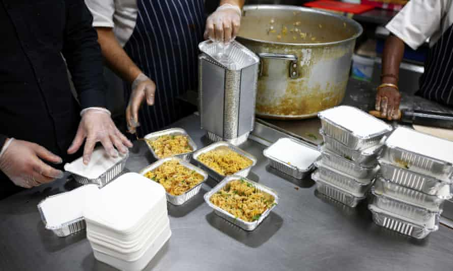 Staff at the Lahore Spice restaurant prepare meals to be donated to homeless people in Tooting, south London.