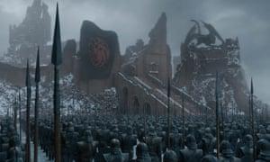 The Targaryen flag flies over the ash-strewn ruins of King's Landing.