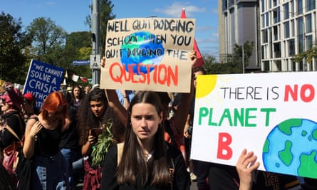 Protesters demanding action on the climate emergency gather in Melbourne.