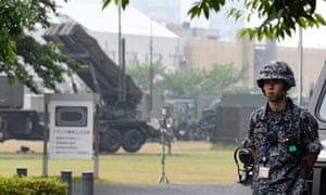 A Japanese soldier stands near a Patriot missile interceptor battery deployed in case of a North Korean missile attack.
