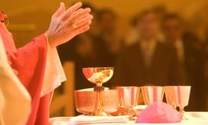 A Catholic priest celebrates Holy Communion