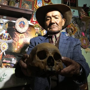 Mariano Huamanrimanchi, 79, shows a relative's skull that he keeps at home out of respect for his ancestors.