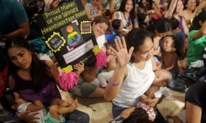 Women breastfeed their children in suburban Manila at the start of August last year to celebrate national breastfeeding awareness month.