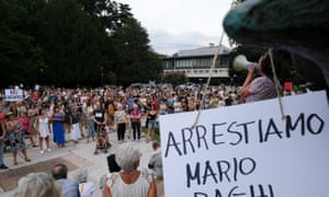 """Demonstration with more than 1000 participants in the squares and streets of the city chanting slogans and showing signs in favor of freedom and against the green pass and the government in Trento, Italy. The health pass, """"Green Pass"""", will be mandatory allowing access to museums, cinemas, gyms, swimming pools, sports stadiums and to be served at indoor tables in restaurants and bars."""