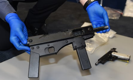 Police display a homemade submachine gun seized on the Gold Coast