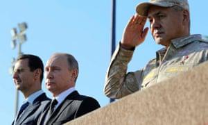 Syrian president Bashar al-Assad(left), Russian president Vladimir Putin (centre) and defence minister Sergei Shoigu visit the Hmeymim airbase in Latakia province