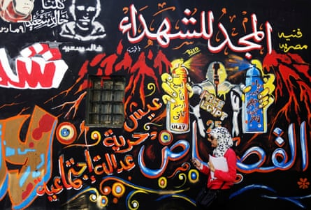 """The graffiti on the walls of Mohamed Mahmoud Street had existed since November 2011, where some of the fiercest fighting between protesters and security forces took place. The Arabic words read, """"Bread, Freedom, Social justice and Glory to the Martyrs""""."""