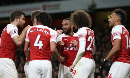 Alexandre Lacazette celebrates with his teammates after scoring Arsenal's second goal.