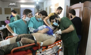Medical staff treat a man suffering from breathing difficulties inside a hospital in Aleppo.