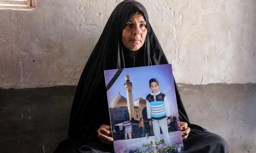The mother of Muhanad, 10, who was killed in the suicide bombing of Al-Shuhadaa Stadium in the city of Iskandariya, Babil Governorate.