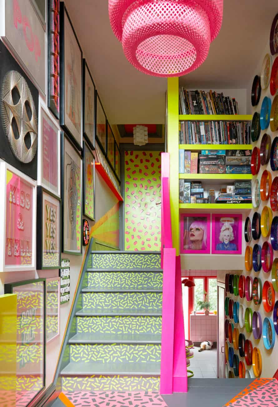 Ms Pink's wall-mounted tray collection and bright staircase