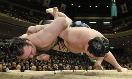 Women are barred from entering sumo rings because it is seen as defiling its purity.