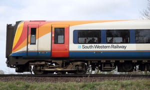 A South Western Railway train makes its way along the line near to Basingstoke in Hampshire