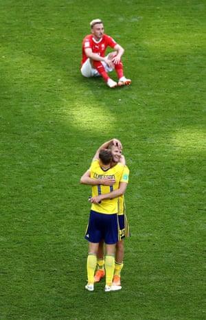 Viktor Claesson and Ola Toivonen celebrate as Josip Drmic sits dejected.