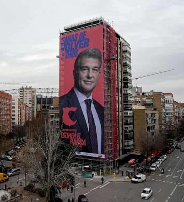 The giant electoral poster of Joan Laporta is displayed on a building next to the Santiago Bernabeu in Madrid.