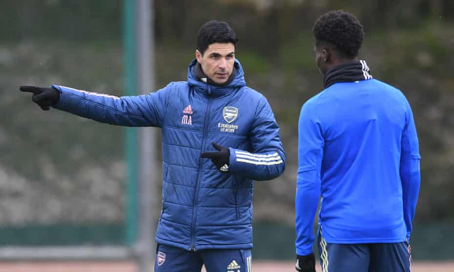 Arsenal's manager Mikel Arteta at a training session with Bukayo Saka, who is available for the Europa League second leg at Slavia Prague.