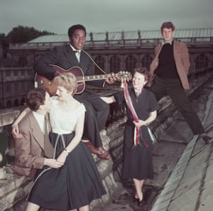 Miller appears amongst students photographed on the roof of Trinity College in Cambridge for Picture Post in 1954